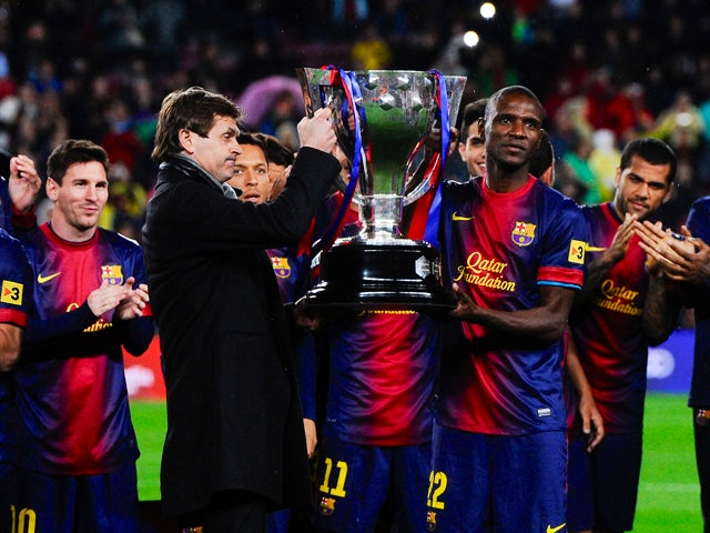 Head coach Tito Vilanova and Eric Abidal of FC Barcelona holds up the trophy during the celebration after winning the Spanish League after the La Liga match between FC Barcelona and Real Valladolid CF at Camp Nou on May 19, 2013