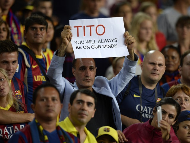 636133ee2 A Barcelona s supporter holds a messae in honour of former coach Tito  Vilanova at the end of the Spanish Super Cup second leg football match FC  Barcelona vs ...