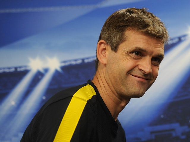 Barcelona's coach Tito Vilanova smiles as he leaves a press conference at Luz Stadium in Lisbon on October 1, 2012