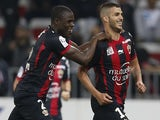 Nice's French midfielder Valentin Eysseric (R) celebrates after scoring a goal during the French L1 football match between OGC Nice and Stade de Reims, on April 26, 2014
