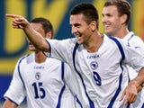 Vedad Ibisevic celebrates scoring for Bosnia on September 07, 2012.