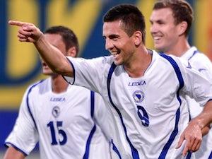 Vedad Ibisevic celebrates scoring for Bosnia on September 07, 2012.