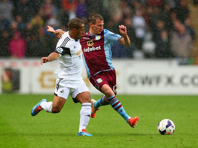 Swansea's Wayne Routledge and Villa's Marc Albrighton in action during the Premier League match on April 26, 2014