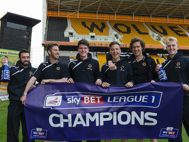 Wolves players celebrate after winning the League One title on April 21, 2014