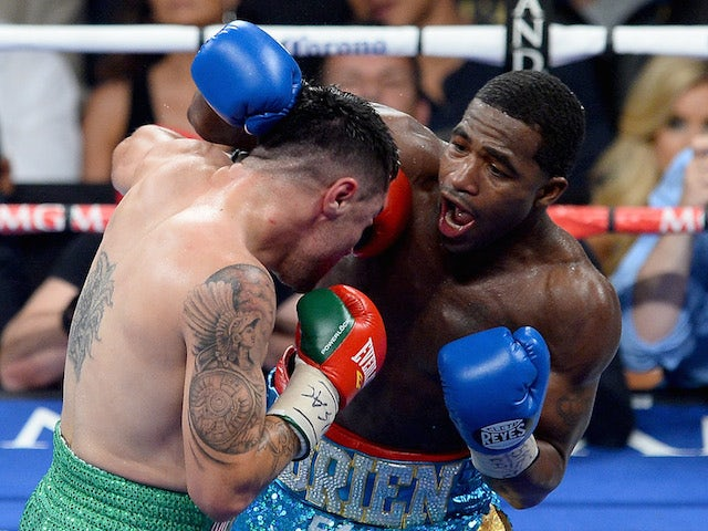 Adrien Broner throws a right at Carlos Molina during their super lightweight bout at the MGM Grand Garden Arena on May 3, 2014