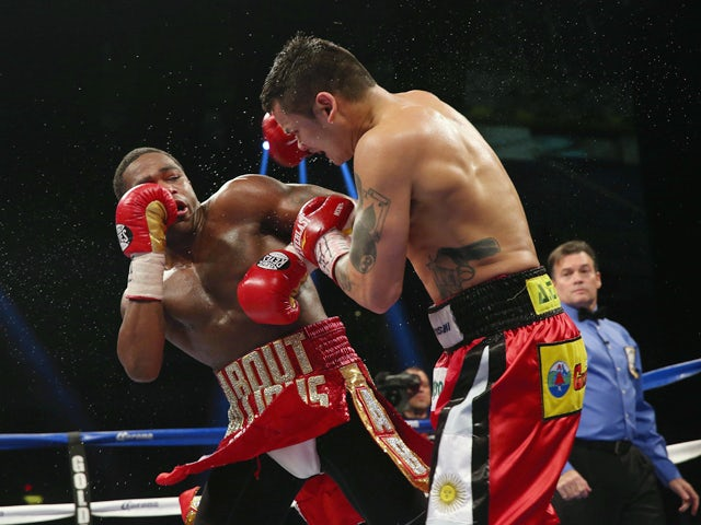 Adrien Broner and Marcos Maidana during their WBA Welterweight Title bout at Alamodome on December14, 2013