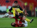 Albert Riera of Watford battles with Diego Poyet of Charlton during the Sky Bet Championship match between Charlton Athletic and Watford at The Valley on April 29, 2014