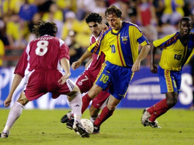 Ecuador captain Alex Aguinaga dribbles with the ball on June 22, 2002.