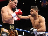 Danny Garcia from Philadelphia, Pennsylvania, takes a right from Amir Khan, R,from Bolton, England on July 14, 2012