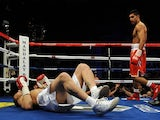 WBA super lightweight champion Amir Khan of England (R) looks at Marcos Maidana of Argentina on December 11, 201