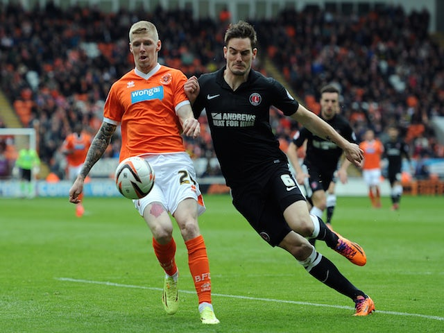 Andy Keogh of Blackpool in action with Dorian Dervite of Charlton Athletic during the Sky Bet Championship match on May 3, 2014