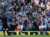 Andreas Weimann of Aston Villa celebrates his goal with Aston Villa fans during the Barclays Premier League match between Aston Villa and Hull City at Villa Park on May 3, 2014