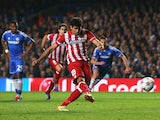 Diego Costa of Club Atletico de Madrid scores from the penalty spot during the UEFA Champions League semi-final second leg match between Chelsea and Club Atletico de Madrid at Stamford Bridge on April 30, 2014