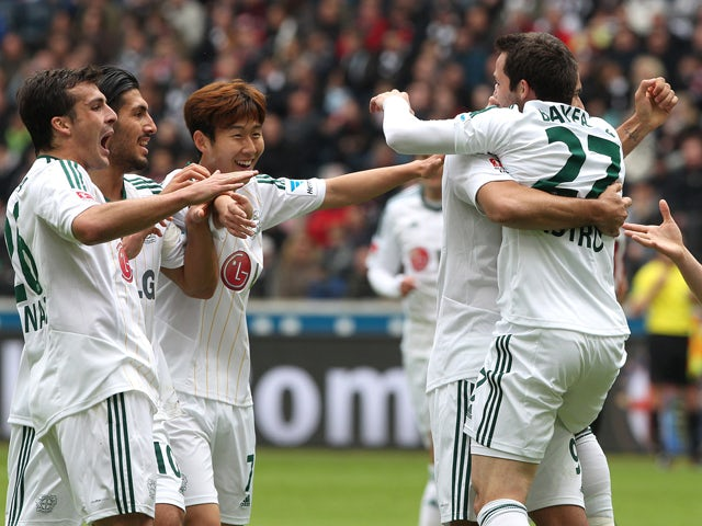Leverkusen's Gonzalo Castro celebrates scoring with his teammates during the German first division Bundesliga football match Eintracht Frankfurt vs Bayer Leverkusen in Frankfurt am Main, western Germany, on May 3, 2014