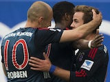 Bayern Munich's Dutch midfielder Arjen Robben celebrates with teammates during the German first division Bundesliga football match Hamburger SV vs FC Bayern Munich in Hamburg, northern Germany, on May 3, 2014