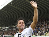 Benito Carbone of Stelle Crociate salutes the crowd before the 100 Years Anniversary match between Stelle Crociate and US Stelle Gialloblu at Stadio Ennio Tardini on October 13, 2013