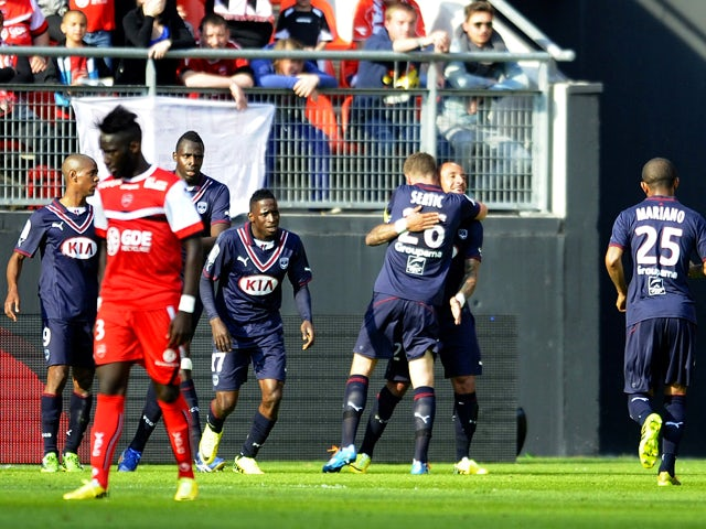 Bordeaux's French defender Julien Faubert celebrates with teammates after scoring a goal during the French L1 football match between Valenciennes and Bordeaux at the Stade du Hainaut in Valenciennes on May 4, 2014