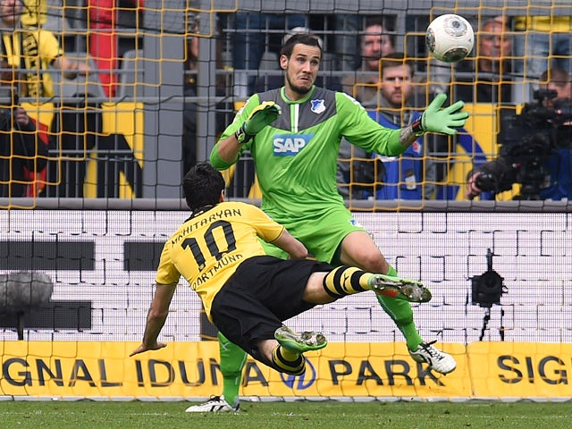 Dortmund's Armenian midfielder Henrikh Mkhitaryan (L) scores during the German first division Bundesliga football match Borussia Dortmund vs 1899 Hoffenheim in Dortmund, western Germany, on May 3, 2014