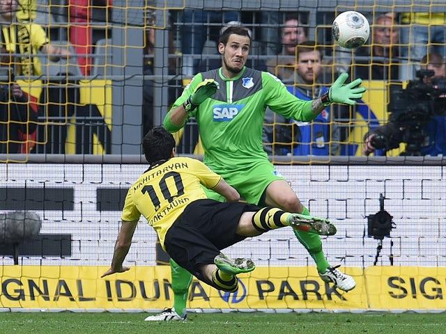 Dortmund's Armenian midfielder Henrikh Mkhitaryan (L) scores during the German first division Bundesliga football match Borussia Dortmund vs 1899 Hoffenheim in Dortmund, western Germany, on May 3, 2014
