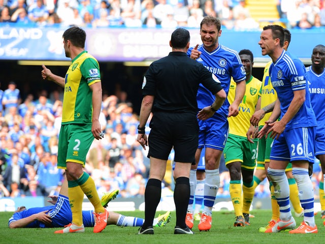 John Terry and Branislav Ivanovic of Chelsea reacts as match referee Neil Swarbrick turns down a penalty appeal during the Barclays Premier League match between Chelsea and Norwich City at Stamford Bridge on May 4, 2014