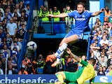 Chelsea's Serbian defender Branislav Ivanovic defends a shot on goal from Norwich City's English midfielder Bradley Johnson (bottom) during the English Premier League football match between Chelsea and Norwich City at Stamford Bridge in London on May 4, 2
