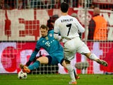Real Madrid's Portuguese forward Cristiano Ronaldo (R) scores the 0-3 past Bayern Munich's goalkeeper Manuel Neuer during the UEFA Champions League second-leg semi-final football match on April 29, 2014