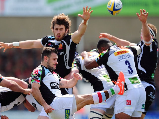 Danny Care of Harlequins puts in a box kick during the Aviva Premiership match between Exeter Chiefs and Harlequins at Sandy Park on May 4, 2014