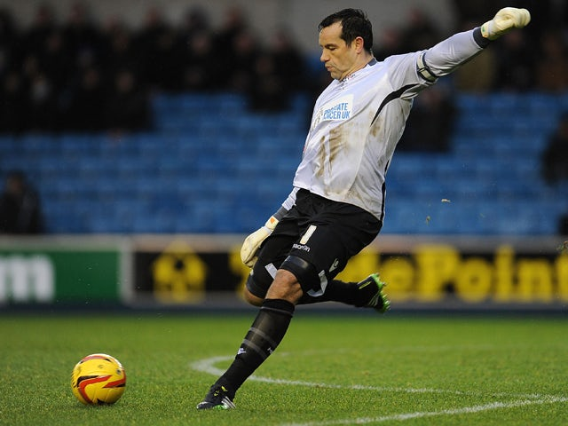 David Forde of Millwall in action during the Sky Bet Championship match between Millwall and Leicester City at The Den on January 01, 2014