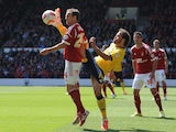 David Vaughan of Nottingham Forest tackled by Inigo Calderon of Brighton & Hove Albion during the Sky Bet Championship match on May 3, 2014