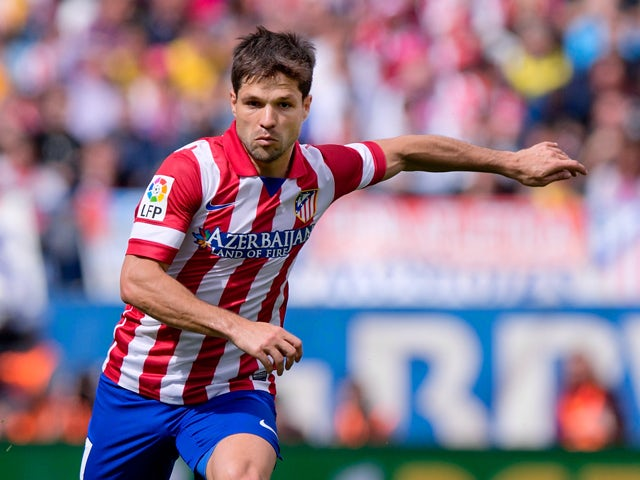 Diego Ribas of Atletico de Madrid controls the ball during the La Liga match between Club Atletico de Madrid and Villarreal CF at Vicente Calderon Stadium on April 5, 2014
