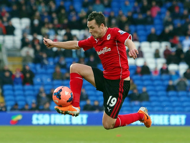 Cardiff City's Scottish midfielder Don Cowie controls the ball during the English FA Cup fifth round football match between Cardiff City and Wigan Athletic at Cardiff City Stadium in Cardiff, south Wales on February 15, 2014