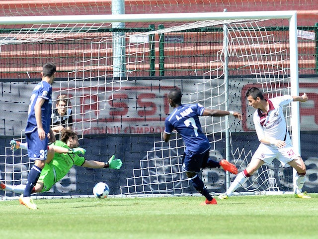 Emanuel Badu #7 of Udinese Calcio scores his team's second goal during the Serie A match between Udinese Calcio and AS Livorno Calcio at Stadio Friuli on May 4, 2014