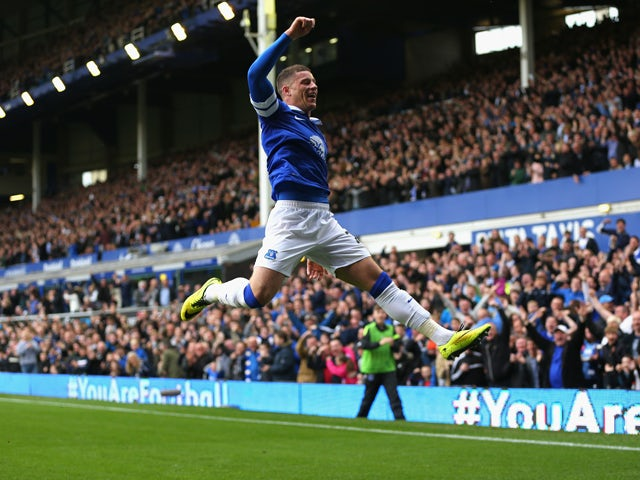 Ross Barkley of Everton celebrates scoring the opening goal during the Barclays Premier League match between Everton and Manchester City at Goodison Park on May 3, 2014