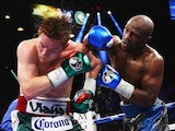 Floyd Mayweather Jr. throws a right to Canelo Alvarez during their WBC/WBA 154-pound title fight at the MGM Grand Garden Arena on September 14, 2013
