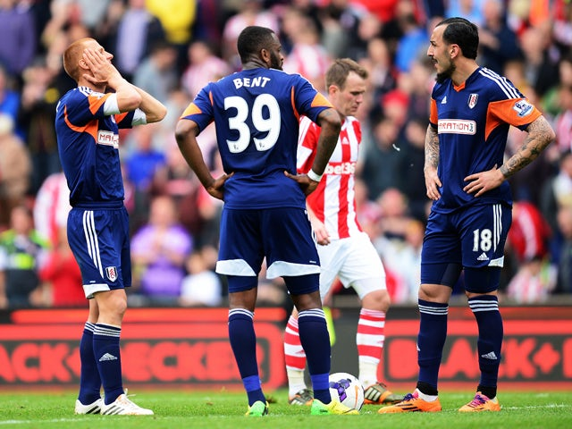 Steve Sidwell, Darren Bent and Konstantinos Mitroglou of Fulham react as their side concedes a third goal during the Barclays Premier League match between Stoke City and Fulham at the Britannia Stadium on May 3, 2014