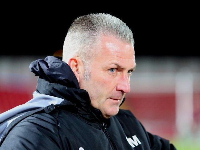 Gateshead manager Gary Mills stands on the touchline during a match against Oxford United on December 05, 2013.