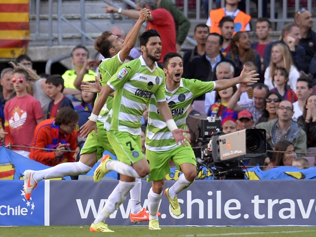 Getafe's players celebrate after scoring a goal during the Spanish league football match FC Barcelona vs Getafe CF at the Camp Nou stadium in Barcelona on May 3, 2014