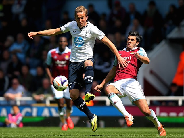 Harry Kane of Spurs is challenged by James Tomkins of West Ham during the Barclays Premier League match on May 3, 2014
