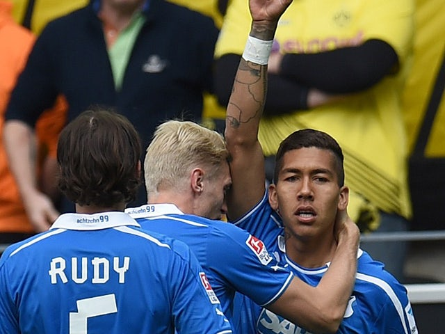 Hoffenheim's Brazilian midfielder Roberto Firmino and his teammates celebrate during the German first division Bundesliga football match Borussia Dortmund vs 1899 Hoffenheim in Dortmund, western Germany, on May 3, 2014