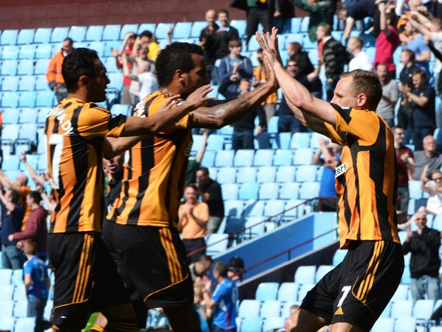 David Meyler of Hull City celebrates their equalising goal, an own goal by Jordan Bowery of Aston Villa, with Tom Huddlestone and Ahmed Elmohamady during the Barclays Premier League match between Aston Villa and Hull City at Villa Park on May 3, 2014
