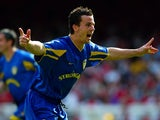 Leeds United defender Ian Harte celebrates scoring against Arsenal on May 04, 2003.