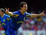 Leeds United defender Ian Harte celebrates scoring against Arsenal on May 04, 2003.