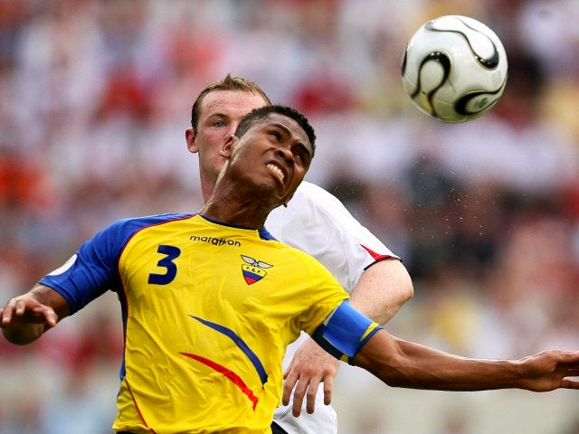 Ecuador defender Ivan Hurtado jumps for the ball against England striker Wayne Rooney on June 25, 2006.