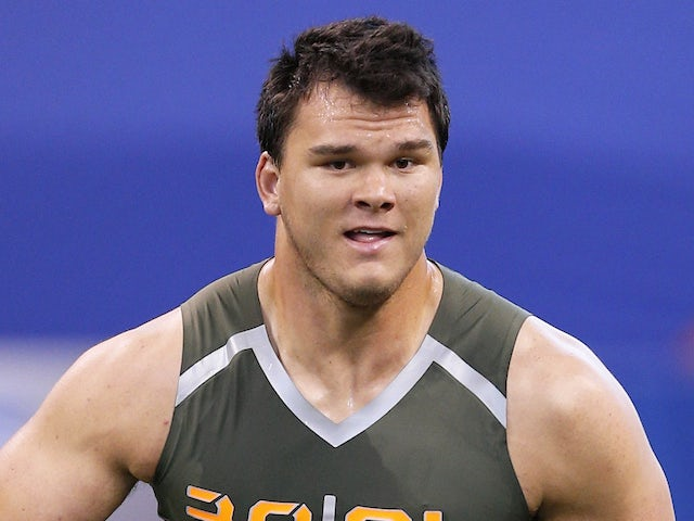 Former Texas A&M offensive lineman Jake Matthews takes part in a drill during the 2014 NFL Combine at Lucas Oil Stadium on February 22, 2014