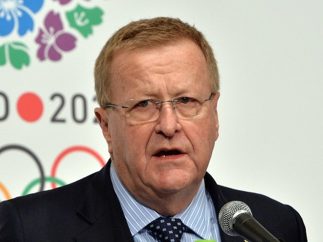 John Coates (L), International Olympic Committee (IOC) Vice President and Chairman of the coordination Commission for the Games of 32th Olympiad pictured on April 4, 2014