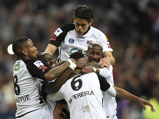 Guingamp's Jonathan Martins Pereira celebrates with teammates after scoring against Rennes during the French Cup final on May 3, 2014