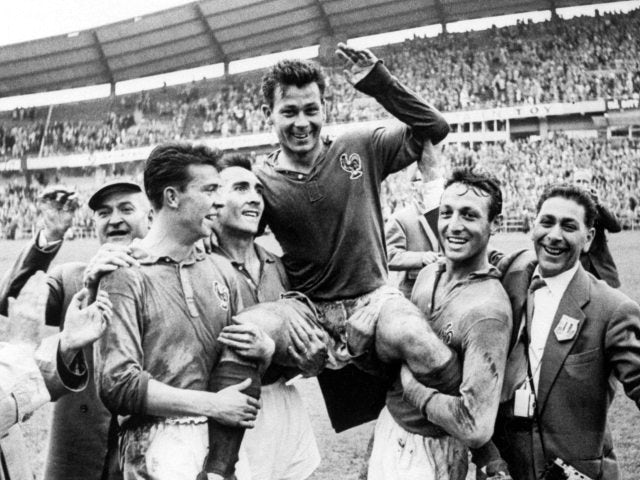 France's Just Fontaine is lifted off the pitch by his teammates on June 28, 1958.