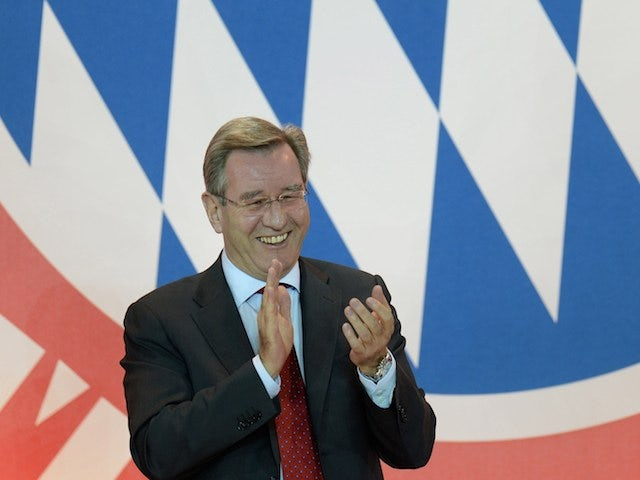 Karl Hopfner, newly elected President of FC Bayern Munich laughs and applauds during the annual general meeting of FC Bayern Munich in Munich, southern Germany, on May 2, 2014