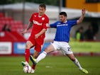 Kyle McFadzean of Crawley Town battles for possesion with Danny Redmond of Carlisle United during the Sky Bet League One match on April 29, 2014