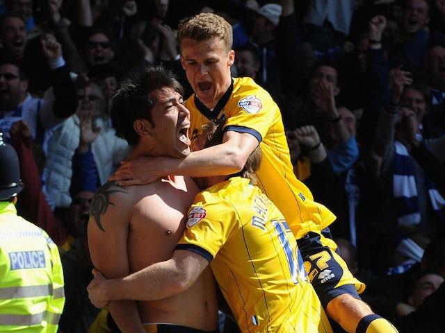 Leonardo Ulloa of Brighton & Hove Albion celebrates scoring the winning goal during the Sky Bet Championship match against Nottingham Forest on May 3, 2014
